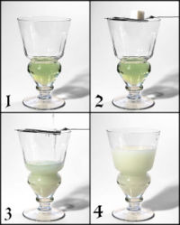 Preparing absinthe the traditional way.